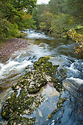 Autumn colour and river in typical Welsh landscape in the Brecon Beacons in Wales, UK
