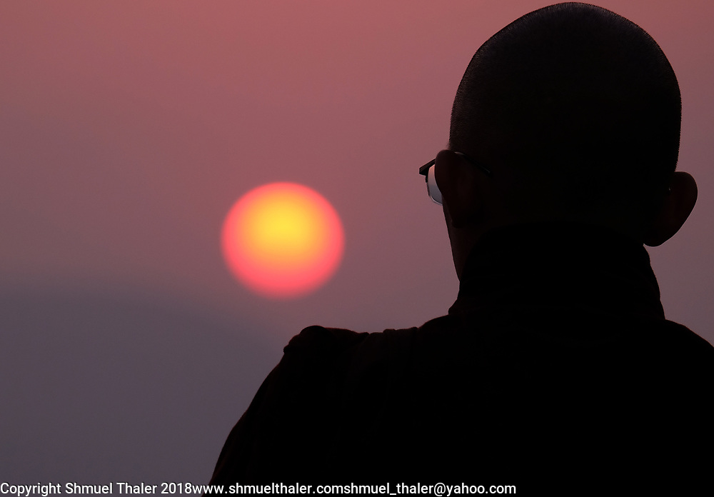 A Vietnamese Buddhist monk watches the sunset from atop Vulture Peak in Rajgir, India, where the Buddha's community first owned land.<br /> Photo by Shmuel Thaler <br /> shmuel_thaler@yahoo.com www.shmuelthaler.com