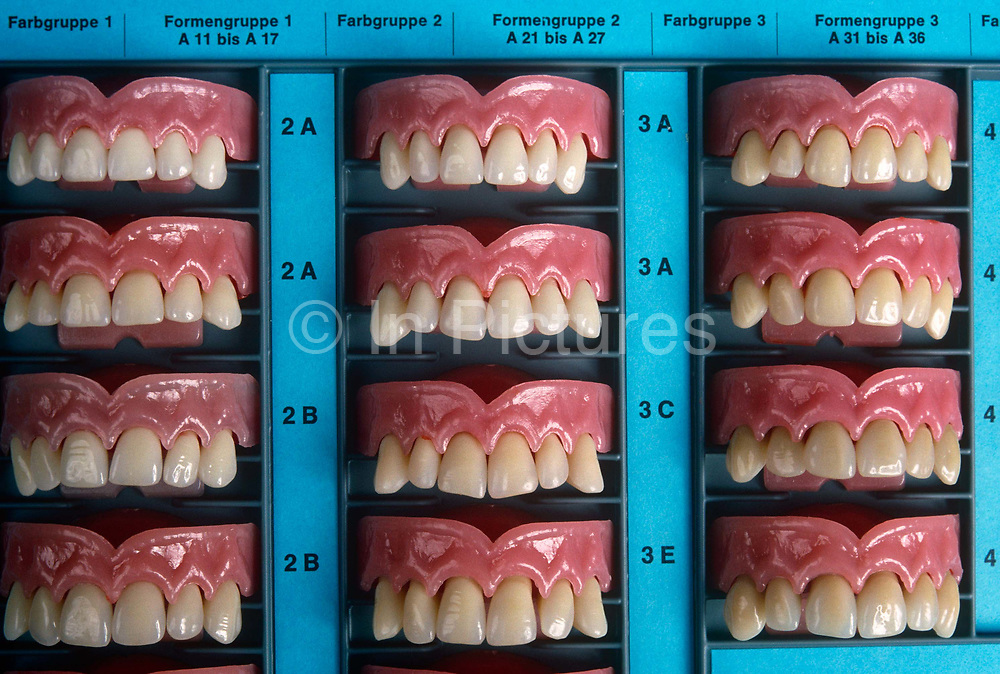 Acrylic teeth samples displayed at Ivoclar Vivadent in Schaan, Liechtenstein who export 60 million false dentures a year worldwide. A board of dental specimens are laid out like grinning mouths at the company showroom. False teeth are Liechtenstein's leading export: Located in the municipality of Schaan, just north of the capital Vaduz, Ivoclar Vivadent is a global dental behemoth. The 60 million artificial teeth the company manufactures annually in 10,000 different shades and shapes, account for 40 per cent of all the false teeth sold in Europe and 20 per cent worldwide. With a turnover of some 600 million Swiss francs, Ivoclar has 1.3 million dentists in 120 countries using its products.