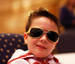 © Licensed to London News Pictures. 07/01/2012. BIRMINGHAM, UK.  Daniel Jenkins (9) practices his 'Elvis face' as he prepares to take part in the annual European Elvis Championship at the Hilton Metropole Hotel at the National Exhibition Centre today.  Photo credit: Alison Baskerville/LNP