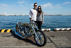 Kiyo Mitsuhiro of Kiyo's Garage with his wife Kat and his twin-4-cylinder Honda drag bike at the Yokohama docks where the invited custom builder's bikes from the USA were unloaded prior to the Mooneyes Yokohama Hot Rod & Custom Show. Yokohama, Japan. December 3, 2016.  Photography ©2016 Michael Lichter.