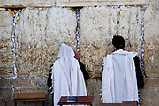 Israel, Jerusalem, Old City, Two Jewish men pray at the Wailing Wall