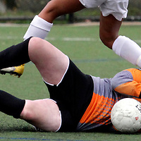 Scotts Valley High keeper Emily Johnson gets a cleat to her neck from Santa Cruz High forward Kiara Burkett as she makes a save for the Falcons during the team's 1-0 loss to Santa Cruz.<br /> Photo by Shmuel Thaler <br /> shmuel_thaler@yahoo.com www.shmuelthaler.com
