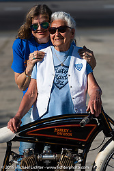 Gloria Struck on Matt Harris' early Harley-Davidson racer with her good friend Cris Simmons on the New Smyrna Speedway after the Sons of Speed Race during Daytona Bike Week. New Smyrna Beach, FL. USA. Saturday March 17, 2018. Photography ©2018 Michael Lichter.
