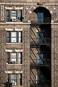 Architectural detail of brownstones popular throught Harlem.  Harlem, a neighborhood of New York City in Manhattan, began as a Dutch village in 1658 and was later annexed to New York City in 1873.  At the beginning of the 20th century African-American's began arriving from the southern American states looking for work in the more industrious north.  With their migration, the African-American community brought with them a renaissance in the arts to Harlem that is still evident today.  After World War II Harlem began experiencing a significant rise in crime and poverty due to the Great Depression that lasted until the 21st century.  A new pride in the community has brought a renewed revival to Harlem, and crime rates have dropped to record lows giving the New York City neighborhood a new lease on life.