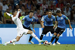 (l-r) Cristiano Ronaldo of Portugal, Nahitan Nandez of Uruguay, Martin Caceres of Uruguay, Lucas Torreira of Uruguay during the 2018 FIFA World Cup Russia round of 16 match between Uruguay and at the Fisht Stadium on June 30, 2018 in Sochi, Russia