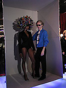 Naomi Campbell and Philip Treacy,  Tanqueray Philip Treacy couture fashion show and after party,  Pink Paradise Club, Paris. 21 January 2003. © Copyright Photograph by Dafydd Jones 66 Stockwell Park Rd. London SW9 0DA Tel 020 7733 0108 www.dafjones.com