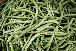 Heap of green beans for sale at market, Puglia, Italy