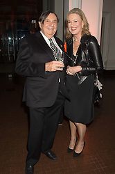 BARRY HUMPHRIES and LADY CONRAN at a dinner to celebrate Sir David Tang's 20 year patronage of the Royal Academy of Arts and the start of building work on the Burlington Gardens wing of the Royal Academy held at 6 Burlington Gardens, London on 26th October 2015.