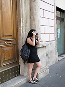 Italy, Rome, Female tourist photographing sites