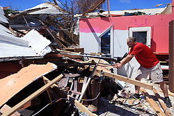 August 29, 2017 - Rockport, Texas, USA - LANCE ESSWEIN digs through the rubble of his wife's antique and resale shop, Brand New Again. The shop was flattened by Hurricane Harvey. ''My wife's dream is in this shop,'' he said. (Credit Image: © Rachel Denny Clow/TNS via ZUMA Wire)