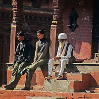 Asia, Nepal, Kathmandu, Bhaktapur. Sitting Men at Nyatapola Temple.
