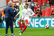 England Midfielder Jesse Lingard warms up before kick off during the FIFA World Cup Qualifier match between England and Malta at Wembley Stadium, London, England on 8 October 2016. Photo by Andy Walter.