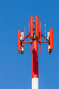 Red and white cellular antenna and pole tower <br />