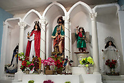 Santeria is a syncretic religion practiced in Cuba, it is a mixture of Yoruba tribal practices brought from Nigeria during Colonial times, and traditional Catholic beliefs. During this time, the slaves used the images of saints to cover up their worship of the Orishas (spirits). The religion grew in social centres called Cabildos. The Cabildo pictured is one of the oldest in Cuba, it is in Palmira; widely regarded as the birthplace of Santeria.