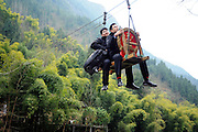 judge rides zip-line to handle case<br /> <br /> A Court judge rides zip-line to handle a case in remote mountains in Fengjie, Chongqing, China on 09 March, 2015.<br /> ©Exclusivepix Media