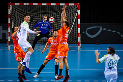 The Dutch handball player Bart Ravensbergen in action against Slovenia during the European Championship qualifying match on January 6, 2020 in Topsportcentrum Almere