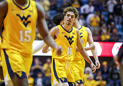 Mar 20, 2019; Morgantown, WV, USA; West Virginia Mountaineers forward Emmitt Matthews Jr. (11) celebrates at the end of the first half against the Grand Canyon Antelopes at WVU Coliseum. Mandatory Credit: Ben Queen