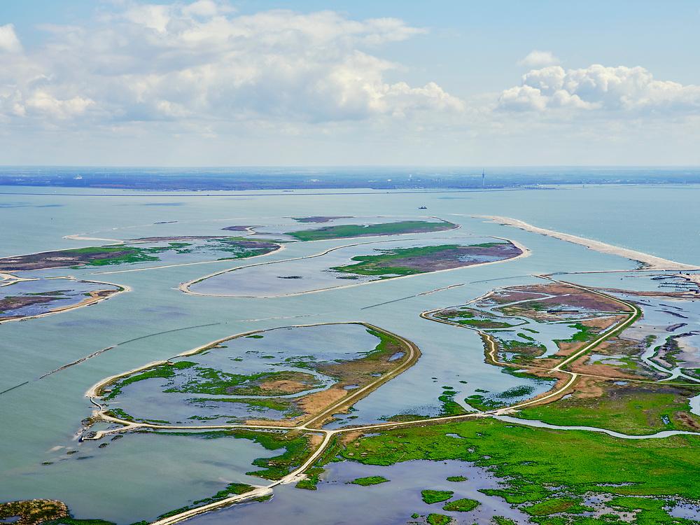 Nederland, Flevoland, Markermeer, 07-05-2021; Marker Wadden in het Markermeer. Gezien vanuit Noordwesten.<br /> Doel van het project van Natuurmonumenten en Rijkswaterstaat is natuurherstel, met name verbetering van de ecologie in het gebied, in het bijzonder de kwaliteit van bodem en water. De Marker Wadden archipel bestaat momenteel uit vijf eilanden, twee nieuwe eilanden zijn in ontwikkeling.<br /> Marker Wadden, artifial islands. The aim of the project is to restore the ecology in the area, in particular the quality of soil and water.<br /> The Marker Wadden archipelago currently consists of five islands, two new islands are under development.<br /> luchtfoto (toeslag op standard tarieven);<br /> aerial photo (additional fee required)<br /> copyright © 2021 foto/photo Siebe Swart
