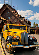 Historic Old Faithful Inn and Yellow Bus, Yellowstone National Park, Wyoming