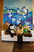 A Japanese tourist having fun with the official Olympic mascots at Whistler's Olympic Store; from l.: Quatchi, Miga, 2x Sumi.