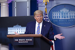 United States President Donald J. Trump, joined by United States Vice President Mike Pence, delivers remarks on the Coronavirus pandemic during a news conference in the James S. Brady Press Briefing room at the White House in Washington D.C., U.S., on Sunday April 19, 2020. Speaker of the United States House of Representatives Nancy Pelosi (Democrat of California) stated that lawmakers are close to a deal with United States Secretary of the Treasury Steven T. Mnuchin regarding a second round of small business loans for businesses impacted by Coronavirus. Credit: Stefani Reynolds / CNP