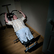 Russian army hazing victim Andrei Sychyov exercises at home in Yekaterinburg..On New Yearís Day in 2006 in the barracks of the Chelyabinsk Tank Academy, a sergeant, possibly drunk, meted out punishment to Pvt. Andrei S. Sychyov..Private Sychyov was forced to squat for three and a half hours. When he complained, as the pain worsened, the sergeant stomped on his ankle twice..Private Sychyov suffered injuries that resulted in infection, then in the amputation of his both legs, a finger, and genitals. .His case became the biggest scandal to reflect the state of Russia's army and the country's human rights situation.