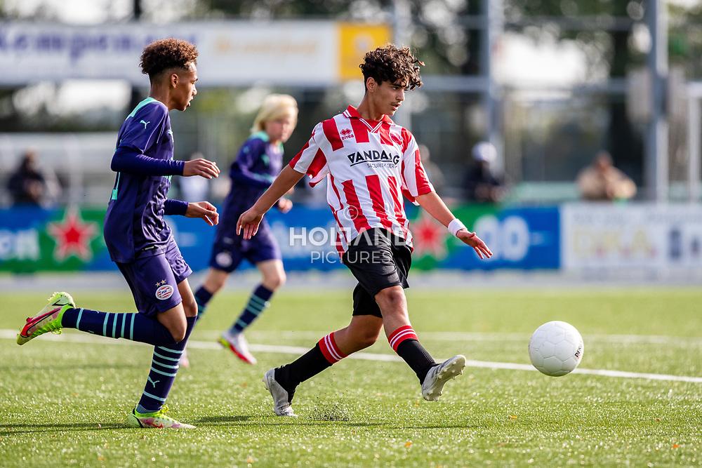 ALPHEN AAN DEN RIJN, NETHERLANDS - OCTOBER 2: (L-R) #11 Gino Verhulst (PSV), #6 Raman Halou (Alphense Boys) during the Divisie 1 A NAJAAR u15 match between Alphense Boys and PSV at Sportpark De Bijlen on October 2, 2021 in Alphen aan den Rijn, Netherlands