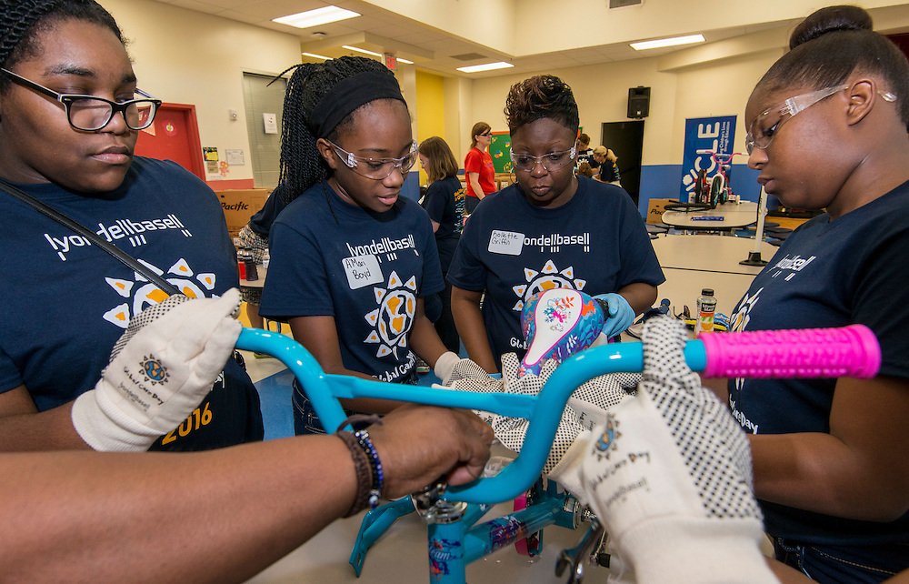 Volunteers from LyondellBasell assemble bicycles to be awarded to students that meet reading goals at Sherman Elementary School, September 10, 2016.