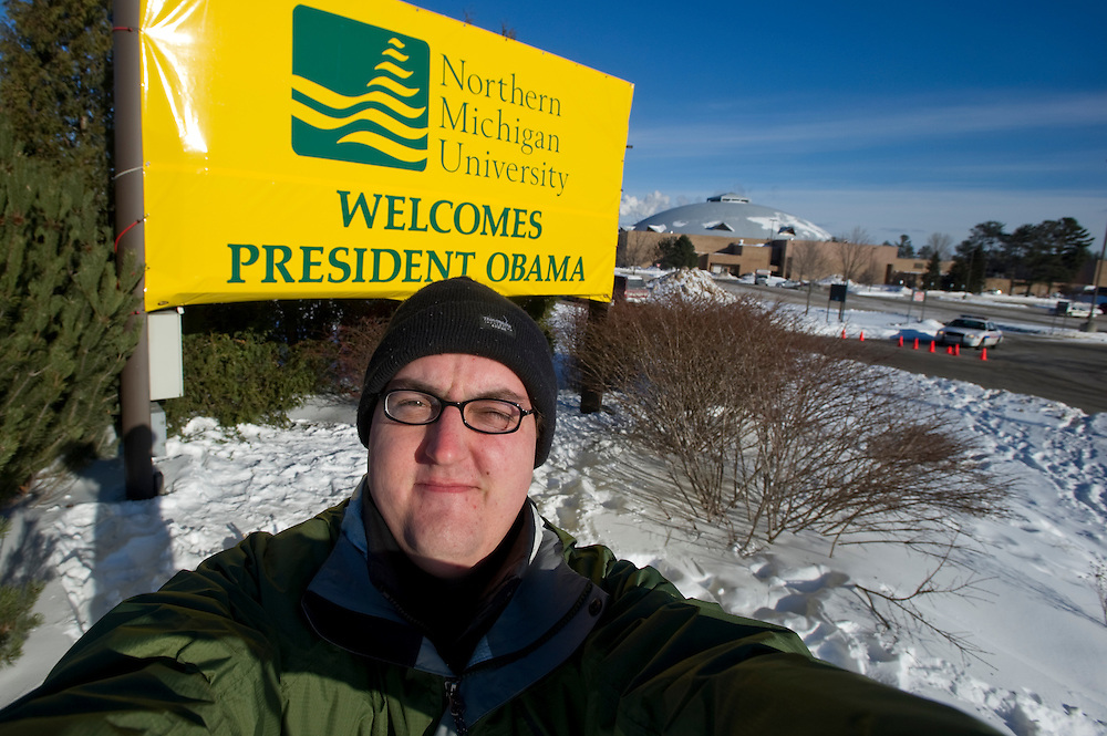 Photographer Aaron Peterson self portrait during President Obama visit to Marquette Michian February 2011.