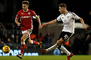 Tom Cairney of Fulham (R) in action with Joe Williams of Barnsley (L). EFL Skybet championship match, Fulham v Barnsley at Craven Cottage in London on Saturday 23rd December 2017<br /> pic by Steffan Bowen, Andrew Orchard sports photography.