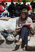 Moscow, Russia, 15/05/2012..A protesting student does her course-work in Chistiye Prudy, or Clean Ponds, as a Moscow court ordered the eviction of some 200 opposition activists who have set up camp in the city centre park.
