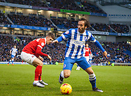 Brighton defender full back Inigo Calderon gets the better of Charlton Athletic midfielder Johann Berg Gudmundsson during the Sky Bet Championship match between Brighton and Hove Albion and Charlton Athletic at the American Express Community Stadium, Brighton and Hove, England on 5 December 2015. Photo by Bennett Dean.