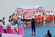 Chungju, South Korea. Women's Eights Medal presentation. Gold medalist USA. W8+. Amanda POLK (b) , Kerry SIMMONDS (2) , Emily REGAN (3) , Lauren SCHMETTERLING (4) , Grace LUCZAK (5) , Meghan MUSNICKI (6) , Victoria OPITZ (7) , Caroline LIND (s) , Katelin SNYDER (c)<br /> <br /> Silver Medalist ROU. W8+. Cristina ILIE (b) , Ionelia ZAHARIA (2) , Cristina GRIGORAS (3) , Ioana CRACIUN (4) , Camelia LUPASCU (5) , Andreea BOGHIAN (6) , Roxana COGIANU (7) , Nicoleta ALBU (s) , Daniela DRUNCEA (c)<br /> <br /> Bronze Medalist CAN. W8+. Lisa ROMAN (b) , Jennifer MARTINS (2) , Carolyn GANES (3) , Susanne GRAINGER (4) , Sarah BLACK (5) , Christine ROPER (6) , Natalie MASTRACCI (7) , Cristy NURSE (s) , Kristen KIT (c). <br /> <br /> 2013 Rowing Championships, Tangeum Lake, International Regatta Course.  Sunday  01/09/2013 [Mandatory Credit. Peter Spurrier/Intersport Images]