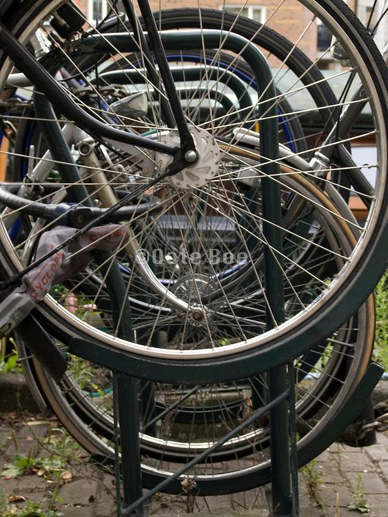 close up of bicycle wheels in bicycle rack