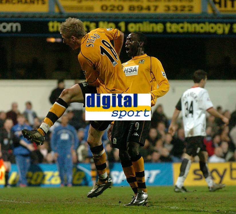 Fotball<br /> Photo: Glyn Thomas, Digitalsport<br /> NORWAY ONLY<br /> <br /> Fulham v Blackburn. FA Barclaycard Premiership. <br /> Loftus Road, Luton. 12/04/2004.<br /> Blackburn's John Stead (L) scores his side's fourth goal as Andy Cole (C) looks on in delight while Fulham's Carlos Bocanegra turns away in disgust.
