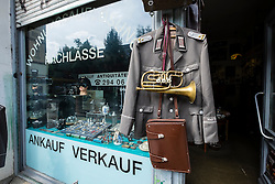 Antique shop selling military items in Friedrichshain district of Berlin Germany
