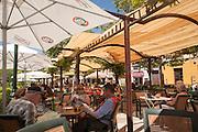 People eating lunch under parasol sunshades, Paseo del Padre Manjob, Albaicin, Granada