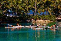 Standup paddleboard yoga class in the lagoon, Four Seasons Resort Bora Bora, French Polynesia.