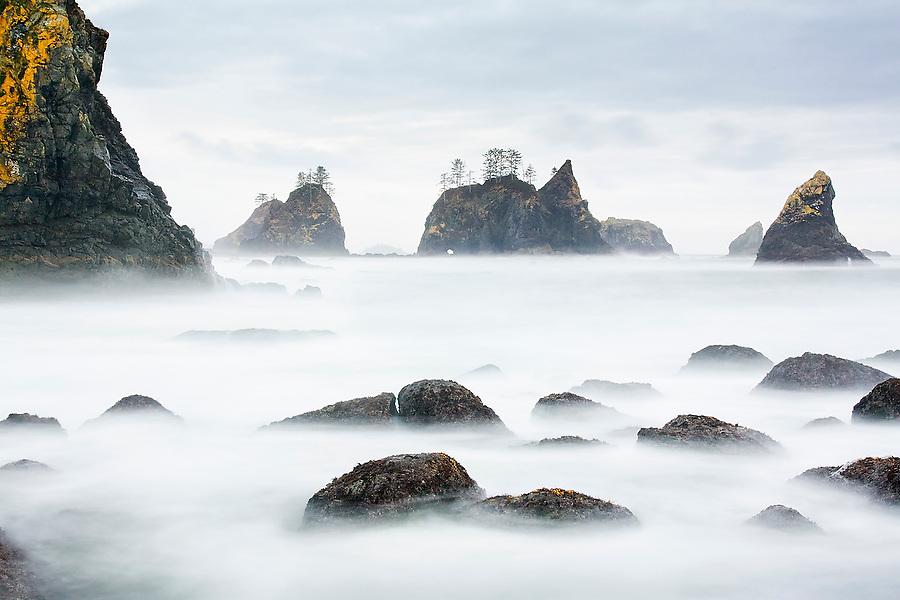 Long exposure of the sea stacks and rocky shore at Shi Shi Beach, Olympic National Park, Washington.