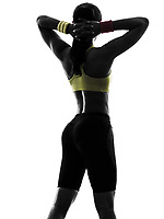one woman exercising fitness workout arms behind head rear view in silhouette on white background
