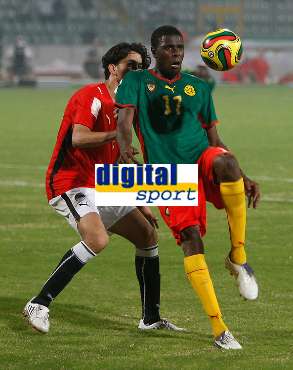 Photo: Steve Bond/Richard Lane Photography.<br />Egypt v Cameroun. Africa Cup of Nations. 22/01/2008. Mohamadou Idrissou (front) tries to shield the ball from Ibrahim Fathalla (back)