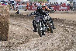 Brad Gregory and Roland Sands Hooligan Flat Track Racing in front of the main stage at the Buffalo Chip during the annual Sturgis Black Hills Motorcycle Rally. SD, USA. August 10, 2016. Photography ©2016 Michael Lichter.