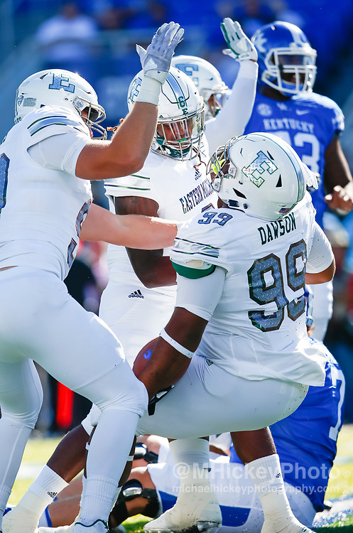 LEXINGTON, KY - SEPTEMBER 30: Members of the Eastern Michigan Eagles defense celebrate during the game against the Kentucky Wildcats at Commonwealth Stadium on September 30, 2017 in Lexington, Kentucky. (Photo by Michael Hickey/Getty Images)