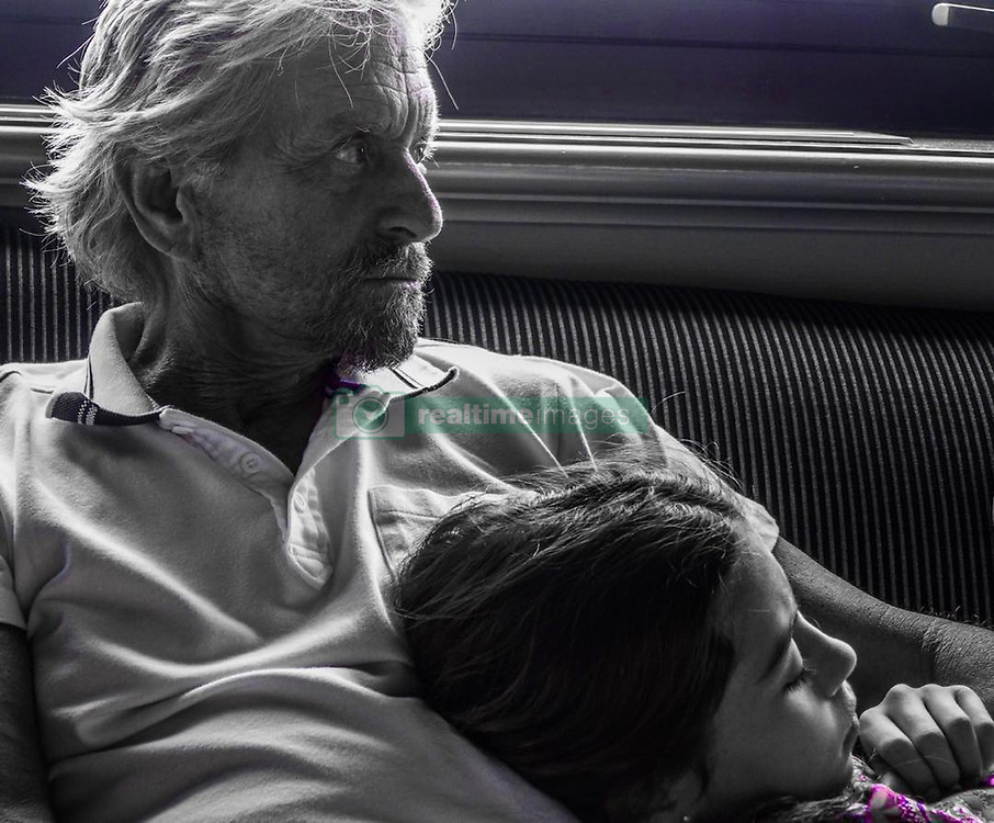 """Catherine Zeta Jones releases a photo on Instagram with the following caption: """"Daddy and daughter\ud83d\ude4f\ud83c\udffbTBT"""". Photo Credit: Instagram *** No USA Distribution *** For Editorial Use Only *** Not to be Published in Books or Photo Books ***  Please note: Fees charged by the agency are for the agency's services only, and do not, nor are they intended to, convey to the user any ownership of Copyright or License in the material. The agency does not claim any ownership including but not limited to Copyright or License in the attached material. By publishing this material you expressly agree to indemnify and to hold the agency and its directors, shareholders and employees harmless from any loss, claims, damages, demands, expenses (including legal fees), or any causes of action or allegation against the agency arising out of or connected in any way with publication of the material."""