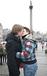 """© licensed to London News Pictures. London, UK 12/02/2012. Gay rights campaigners kissing at Trafalgar Square before posting a Valentine's Day card to Buckingham Palace calling on the Queen to help """"kiss goodbye to homophobia"""" in some Commonwealth countries. Photo credit: Tolga Akmen/LNP"""
