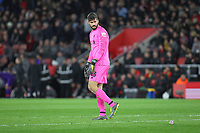 Football - 2018 / 2019 Premier League - Southampton vs. Liverpool<br /> <br /> Alisson of Liverpool looks round as a second drinks bottle lands on the pitch behind him after Liverpool scored there third goal at St Mary's Stadium Southampton<br /> <br /> COLORSPORT/SHAUN BOGGUST