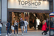 Customers coming out of the Top Shop flagship store, Oxford Street, London.
