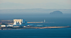 Torness Power Station nuclear power station at Torness with the Barns Ness lighthouse middle, and the Bass Rock visible on the right. Viewed from Greenside Hill on the north side of the A1107 road between Cockburnspath and Coldingham...