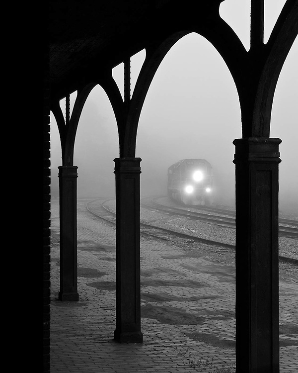 Early morning fog blankets the yard at Salamanca as the daily road train conducts a few switching moves before getting under way. Viewed from the original Buffalo, Rochester & Pittsburgh RR Station building, this yard has seen a lot of changes including ownership by B&O, Chessie, CSX, and now the Buffalo & Pittsburg.